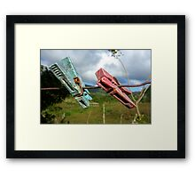 Two aged clothespin as friends on a clothes line Framed Print