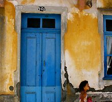 girl by the blue door by Sonia de Macedo-Stewart