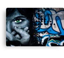 Graffiti face on the textured brick wall Canvas Print