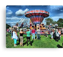 The Roundabout at Hawkesbury Upton Fair and Horticultural Show.   Canvas Print