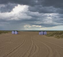 Beach huts and storm clouds by oddity