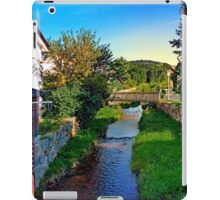 A river, a bridge and lots of green | waterscape photography iPad Case/Skin