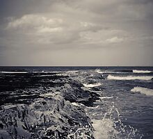 waves crashing against rocks 2 by Phillip Shannon