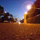 Tram stop on Lygon Street by Ameel Khan