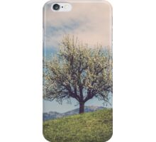Blossom tree on a hill in Switzerland iPhone Case/Skin