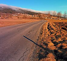 Winter road into the mountains | landscape photography by Patrick Jobst