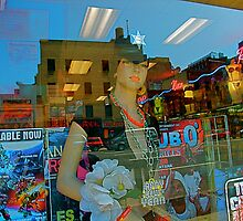 Reflections in a shop window, 32nd St. and Eighth Ave., NYC by RonnieGinnever