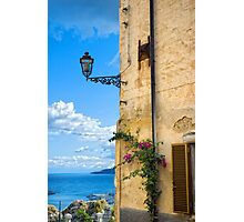House with bougainvillea, street lamp and distant sea Photographic Print