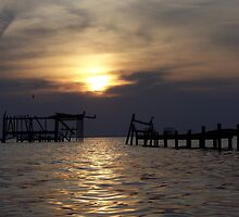 Skeleton pier sunset on Mobile Bay by lanie26