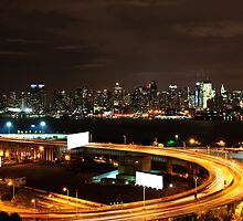 NYC Skyline Cityscape at Night over Hudson river. by Noel Moore Up The Banner Photography