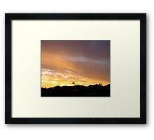 over the rooftops Framed Print