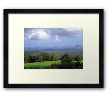 Grazing under the clouds Framed Print