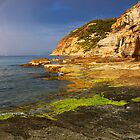 Rainbow over the sea by Patrick Morand
