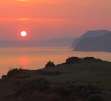 Sunset From Jurassic Coast by rumisw