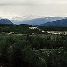 Snow on the mountains around Lake Tornetrask Sweden 198406180006 by Fred Mitchell