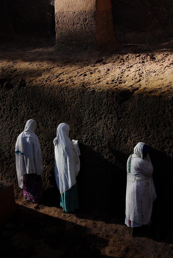 Women praying outside Lalibela church by Euphemia