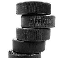 Ice hockey pucks by Sandra O'Connor