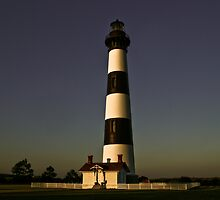 Bodie Island Lighthouse at sunset by Dave Parrish