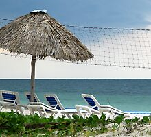 Umbrella and chairs on the beach at Cayo Levisa, Cuba by ecotterell