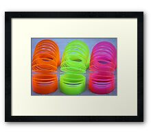 Neon Slinkies Framed Print