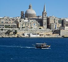 Valletta Waterfront and Colourful Luzzu Fishing Boat by HotHibiscus