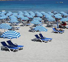 Blue Striped Sun Parasols on White Sandy Beach of Malta by HotHibiscus