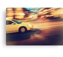 Taxi driving in the city Canvas Print