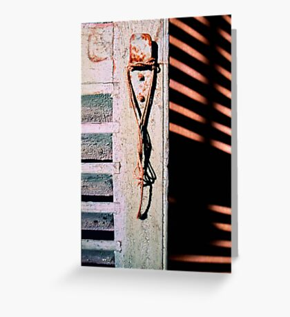 Hanging rope, old shutter and shadows Greeting Card
