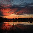 Cloudy sunrise by kathy s gillentine