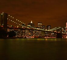 Brooklyn Bridge and NYC by night by Andrea Rapisarda