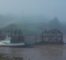 Fishing boat in the fog by AskinImages