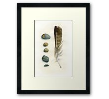 Stones and feather Framed Print