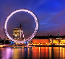 London Eye at Night reflected in the Thames by Giovanna Tucker