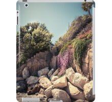 Lonely palm tree on the rocky coast iPad Case/Skin