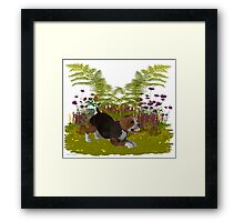 April Puppy .. playing in the garden Framed Print