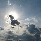 Bright sun behind cloud by LeeHicksPhotos
