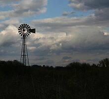 windmill outlined with clouds by Nicholas Caruolo