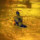 A Puddle Bath..... by Larry Llewellyn
