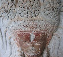 carved apsara face by Collymarps