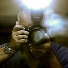 Photographer Capturing Light Through a Mirror by Buckwhite