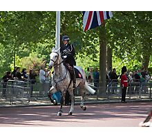 Police horse gallops up the mall at the State Opening Of Parliament London Photographic Print