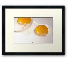 Two raw eggs over highlight Framed Print