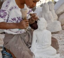 a boy chisels in workshop of Buddha Statues Sticker