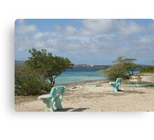blue benches at the beach Canvas Print