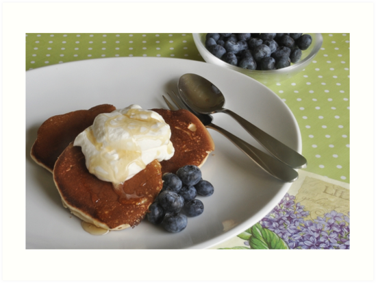 Crumpets, cream and blueberries by Heather Thorsen