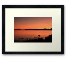 Boat ride at sunset Framed Print