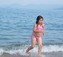 Happy child in Aegian Sea by costy33