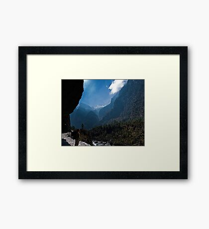 A girl looking out on to mountains Framed Print