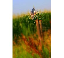 Old American flag on fence post Photographic Print