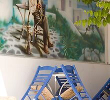 Waterpipe And Blue Chairs by phil decocco